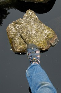 stepping onto a stone