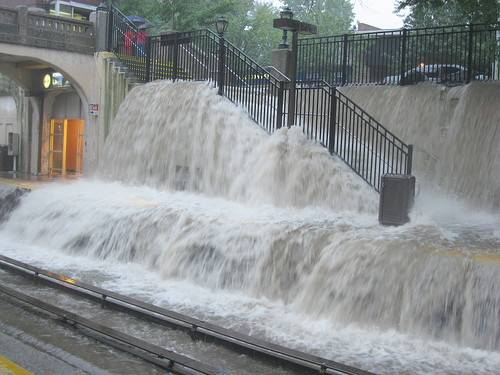 a picture of a flooding street and subway terminal as a metaphor for menstrual flooding