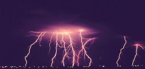 lightning strikes above a city