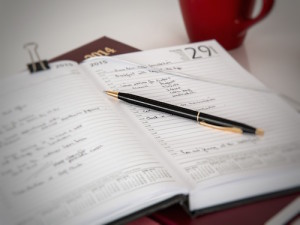 picture of an open diary or journal and schedule for holiday activities