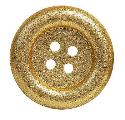 a button covered in gold glitter as a metaphor for the clitoris