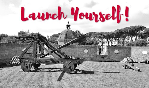 a black and white photo of a catapult with the words 'launch yourself' above the machine as a metaphor for meeting goals