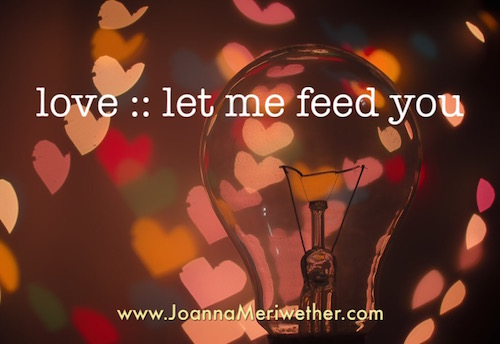 """dim lightbulb with hearts as shadows on the wall around it with the words """"love: let me feed you"""" on it as a symbol of receiving love from others"""