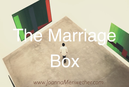 "a person in an art studio with the words ""the marriage box"" on it"