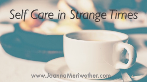a tea cup sits in front of food on a table with the words 'self-care in strange times' positioned above the cup