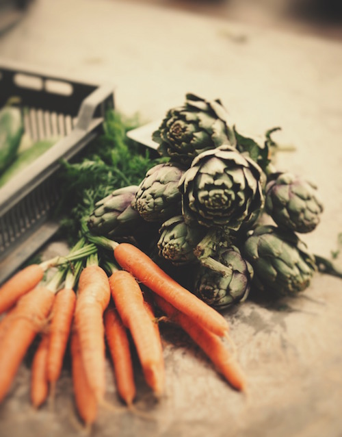 carrots and artichokes on a table as a symbol of holiday food and stress
