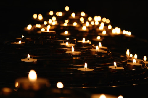 many small candles on water as a symbol of telling the truth and finding the path