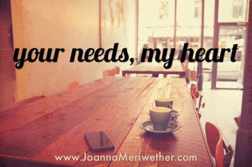 two cups of coffee on a wooden table in a cafe with the words 'your needs, my heart' at the top