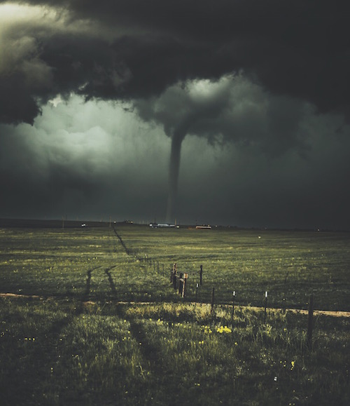 picture of a stormy sky with a tornado touching down as a metaphor for a life filled with drama