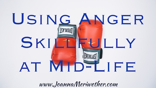 "two red boxing gloves with the words ""Using Anger Skillfully at Mid-Life"" transposed over the top"