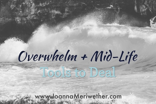 a large wave crashing on some rocks with the words 'mid-life and overwhelm' across the top
